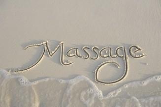 massage skrivet i sand.jpg